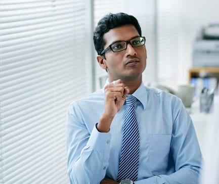 Portrait of pensive Indian businessman in office