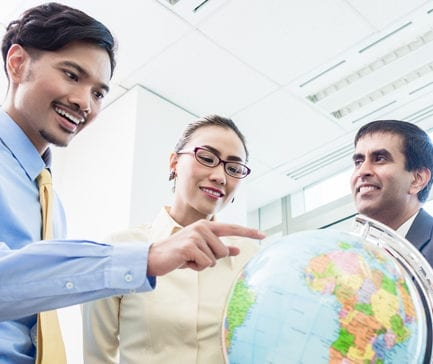 Asian businesspeople in office talk about global strategy and new markets